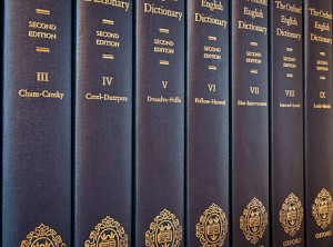 Seven of the twenty volumes of the printed version of the second edition of the OED