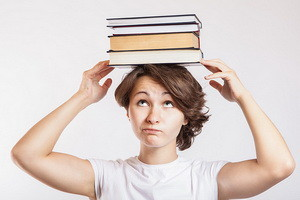 Schoolgirl with books on head 7658034524_cea1c4ddba 300 x 200