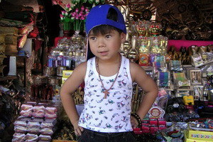 Thai_boy_selling_souvenirs 300 x 200